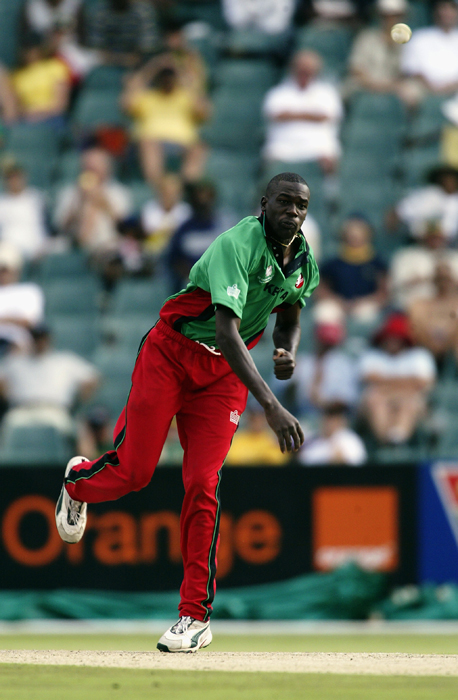 Collins Obuya of Kenya bowling