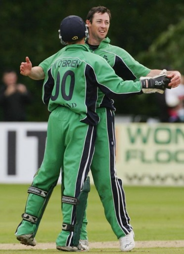 BELFAST, UNITED KINGDOM - JUNE 24: Alex Cusack (R) and Niall O'Brien of Ireland celebrate the wicket of Herschelle Gibbs of South Africa during the One Day International match between Ireland and South Africa at the Civil Service Cricket Club in Stormont on June 24, 2007 in Belfast, Northern Ireland. (Photo by Hamish Blair/Getty Images)