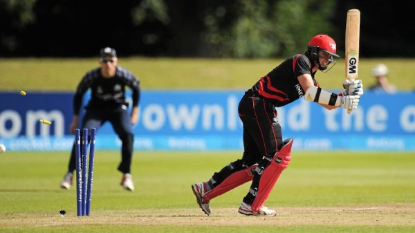 25 July 2015; Hong Kong's Mark Chapman is bowled out by Scotland's Safyaan Sharif. ICC World Twenty20 Qualifier 2015 Semi-Final, Scotland v Hong Kong. Malahide, Dublin. Picture credit: Seb Daly / ICC / SPORTSFILE