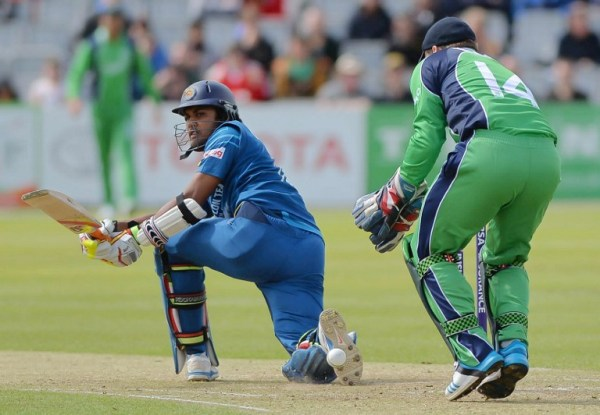 Sri Lanka's Dinesh Chandimal (L) bats during a One Day International cricket match between Ireland and Sri Lanka at Clontarf Cricket Club in Dublin, Ireland, on May 6, 2014. AFP PHOTO / ARTUR WIDAK