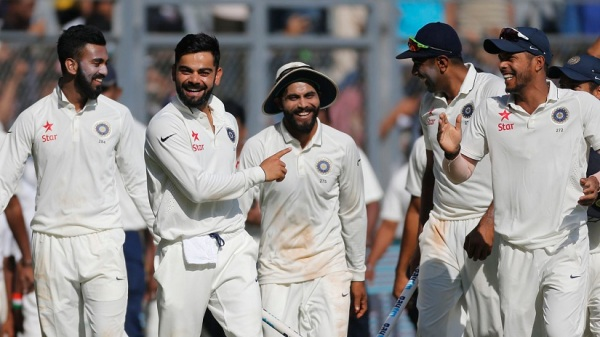 India's captain Virat Kohli, second from left, carries a wicket as he celebrates with his team players after their win over England on the fifth day of the fourth cricket test match between India and England in Mumbai, India, Monday, Dec. 12, 2016. (AP Photo/Rafiq Maqbool)